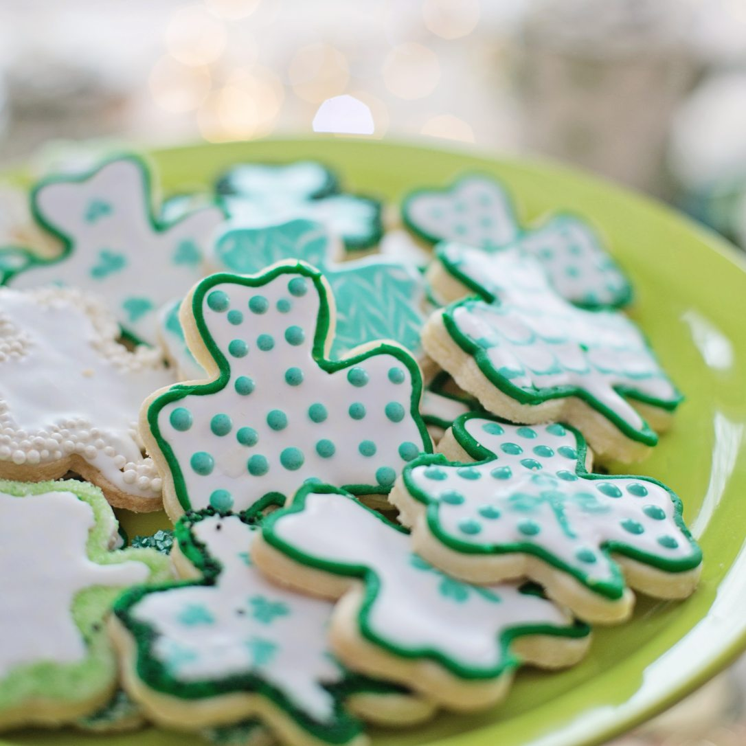 St Patrick's Day 2020 green-and-blue-clover-shaped-cookies-on-plate-3860490